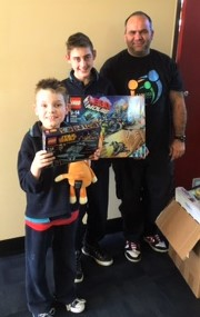 Two of the Nepean School boys excited about their new Legos and games.