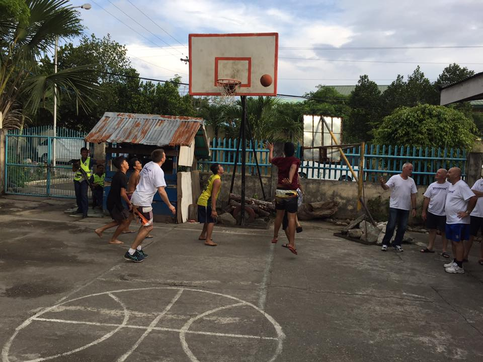 Sancss_team_playing_basketball_with_ormoc_boys