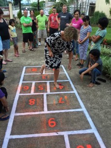 Girls being introduced to hopscotch