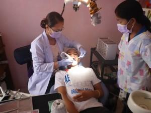 Dentist hard at work.