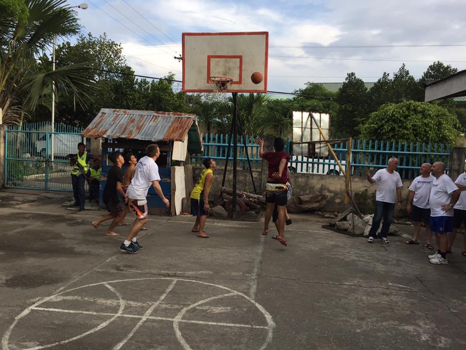 Sancss_team_playing_basketball_with_ormoc_boys